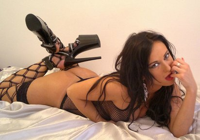 Check up this fascinating picture where petite camgirl Nele in black stockings posing on cam.